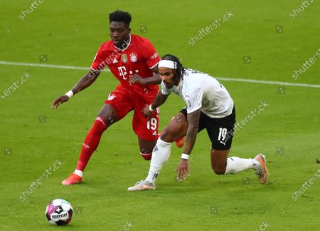 Bayern's Alphonso Davies (L) in action against Moenchengladbach's Valentino Lazaro (R)  during  the German Bundesliga soccer match between FC Bayern Munich and Borussia Moenchengladbach in Munich, Germany, 08 May 2021.