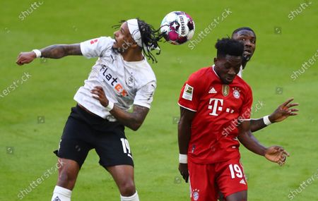 Stock Image of Moenchengladbach's Valentino Lazaro (L) in action against Bayern's Alphonso Davies (R)  during  the German Bundesliga soccer match between FC Bayern Munich and Borussia Moenchengladbach in Munich, Germany, 08 May 2021.