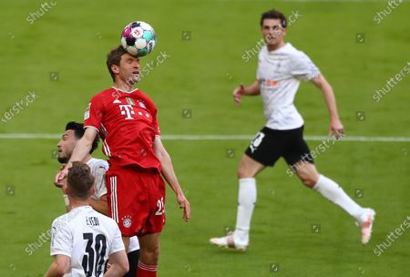 Bayern's Thomas Mueller (3-L) in action during  the German Bundesliga soccer match between FC Bayern Munich and Borussia Moenchengladbach in Munich, Germany, 08 May 2021.