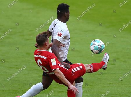 Stock Picture of Bayern's Joshua Kimmich (L) in action against Moenchengladbach's Breel Embolo (R)  during  the German Bundesliga soccer match between FC Bayern Munich and Borussia Moenchengladbach in Munich, Germany, 08 May 2021.
