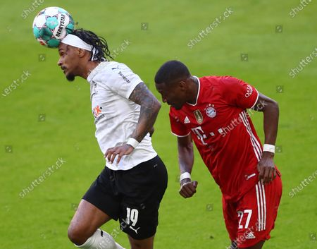 Moenchengladbach's Valentino Lazaro (L) in action against Bayern's David Alaba (R)  during  the German Bundesliga soccer match between FC Bayern Munich and Borussia Moenchengladbach in Munich, Germany, 08 May 2021.