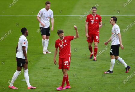 Bayern's Thomas Mueller (C) reacts during  the German Bundesliga soccer match between FC Bayern Munich and Borussia Moenchengladbach in Munich, Germany, 08 May 2021.