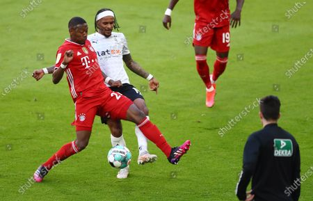 Bayern's David Alaba (L) in action against Moenchengladbach's Valentino Lazaro (R)  during  the German Bundesliga soccer match between FC Bayern Munich and Borussia Moenchengladbach in Munich, Germany, 08 May 2021.
