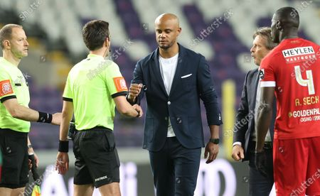 referee Erik Lambrechts, Anderlecht's head coach Vincent Kompany and Anderlecht's head coach Vincent Kompany pictured after a soccer match between RSC Anderlecht and Royal Antwerp FC, Saturday 08 May 2021 in Brussels, on the day 2 out of 6, in the 'Champions' play-offs' of the 'Jupiler Pro League' first division of the Belgian championship.