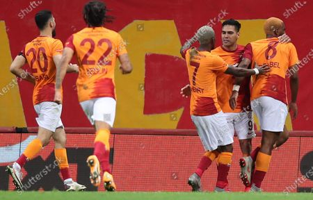 Stock Photo of Radamel Falcao (2-R) of Galatasaray celebrates with teammates after scoring the 2-1 goal from the penalty spot during the Turkish Super League soccer match between Galatasaray and Besiktas in Istanbul, Turkey, 08 May 2021.