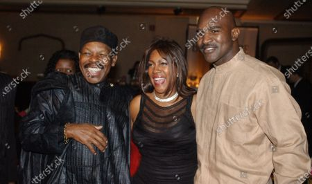 """Lloyd Price, left, and Mary Wilson, of the Supremes, pose for a photograph with boxer Evander Holyfield during the reception of the 13th Annual Pioneer Awards presented by the Rhythm & Blues Foundation in New York. The New Orleans mainstay and Rock and Roll Hall of Famer has died. Price was known for such hits as """"Lawdy Miss Clawdy"""" and """"Stagger Lee."""" His wife Jackie said he died in New Rochelle, N.Y"""