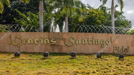 Stock Photo of Fountain with a short phrase by Fidel Castro. It reads 'Thank You Santiago'. It is located in Santiago de Cuba, Cuba