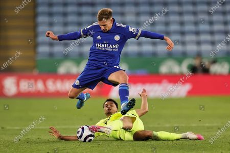 Marc Albrighton of Leicester City jumps to avoid a tackle from Jacob Murphy of Newcastle United during the Premier League match between Leicester City and Newcastle United at the King Power Stadium, Leicester on Friday 7th May 2021.