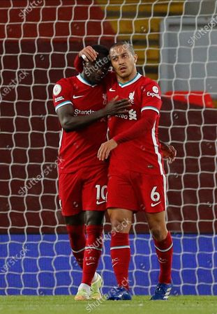 Liverpool's Sadio Mane (L), assisted by Liverpool's Thiago Alcantara (R), reacts after scoring during the English Premier League soccer match between Liverpool FC and Southampton FC in Liverpool, Britain, 08 May 2021.
