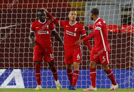 Liverpool's Sadio Mane (L), assisted by Liverpool's Thiago Alcantara (C) and Liverpool's Georginio Wijnaldum (R), reacts after scoring during the English Premier League soccer match between Liverpool FC and Southampton FC in Liverpool, Britain, 08 May 2021.