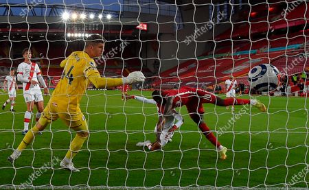 Liverpool's Sadio Mane (R- in red) scores the opening goal against Southampton's goalkeeper Fraser Forster (L) during the English Premier League soccer match between Liverpool FC and Southampton FC in Liverpool, Britain, 08 May 2021.