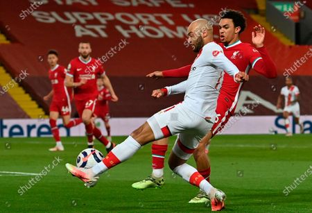 Southampton's Nathan Redmond (L) is tackled by Liverpool's Trent Alexander-Arnold (R) during the English Premier League soccer match between Liverpool FC and Southampton FC in Liverpool, Britain, 08 May 2021.