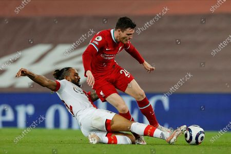 Liverpool's Andrew Robertson (R) is tackled bySouthampton's Theo Walcott (L) during the English Premier League soccer match between Liverpool FC and Southampton FC in Liverpool, Britain, 08 May 2021.