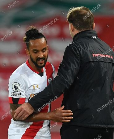 Southampton's manager Ralph Hasenhuettl (R) comforts Southampton's Theo Walcott (L) after replacing him during the English Premier League soccer match between Liverpool FC and Southampton FC in Liverpool, Britain, 08 May 2021.