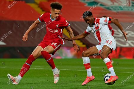 Liverpool's Rhys Williams (L) in action with Southampton's Nathan Tella (R) during the English Premier League soccer match between Liverpool FC and Southampton FC in Liverpool, Britain, 08 May 2021.