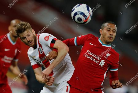 Southampton's Stuart Armstrong (L) in action with Liverpool's Thiago Alcantara (R) during the English Premier League soccer match between Liverpool FC and Southampton FC in Liverpool, Britain, 08 May 2021.