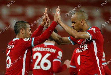 Liverpool's Thiago Alcantara (L), assisted by Liverpool's Fabinho (R), reacts after scoring during the English Premier League soccer match between Liverpool FC and Southampton FC in Liverpool, Britain, 08 May 2021.