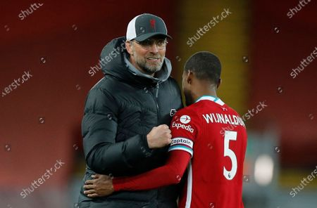 Liverpool's head coach Juergen Klopp (L) reacts after embracing Liverpool's Georginio Wijnaldum (R) after the English Premier League soccer match between Liverpool FC and Southampton FC in Liverpool, Britain, 08 May 2021.