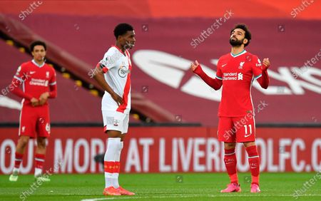 Liverpool's Mohamed Salah (R) prays as Southampton's Nathan Tella (C) looks on before the English Premier League soccer match between Liverpool FC and Southampton FC in Liverpool, Britain, 08 May 2021.