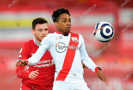 Liverpool's Andrew Robertson (L) in action with Southampton's Kyle Walker-Peters (R) during the English Premier League soccer match between Liverpool FC and Southampton FC in Liverpool, Britain, 08 May 2021.