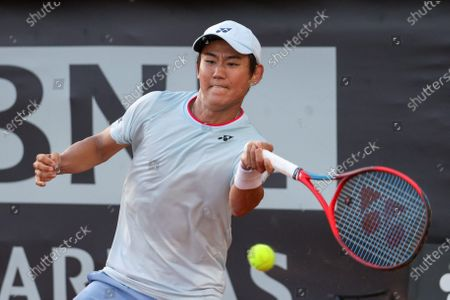 Stock Picture of Yoshihito Nishioka of Japan in action during a tennis match against Gregoire Barrere of France at Internazionali BNL D'Italia in Rome, Italy on May 08, 2021.