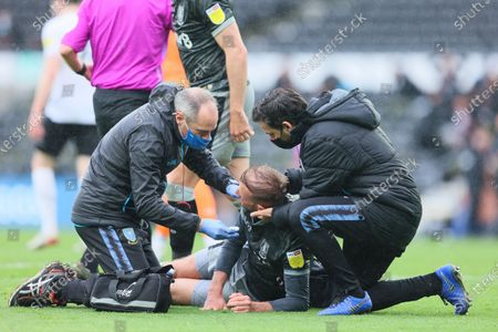 Jordan Rhodes of Sheffield Wednesday goes down injured during the Sky Bet Championship match between Derby County and Sheffield Wednesday at Pride Park, Derby on Saturday 8th May 2021.
