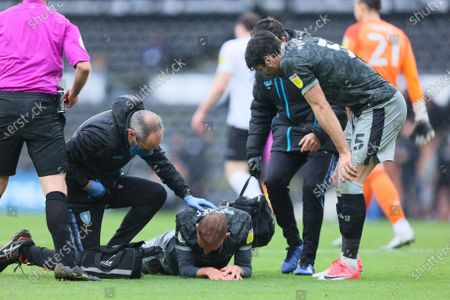 Stock Image of Jordan Rhodes of Sheffield Wednesday goes down injured during the Sky Bet Championship match between Derby County and Sheffield Wednesday at Pride Park, Derby on Saturday 8th May 2021.