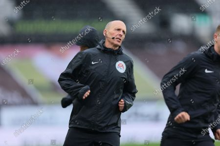 Mike Dean, the match referee, warming up before the Sky Bet Championship match between Derby County and Sheffield Wednesday at Pride Park, Derby on Saturday 8th May 2021.