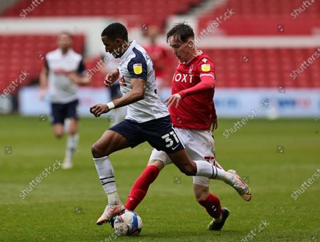 Yuri Oliveira Ribeiro of Nottingham Forest tackles Scott Sinclair of Preston North End during the Sky Bet Championship match between Nottingham Forest and Preston North End at the City Ground, Nottingham on Saturday 8th May 2021.