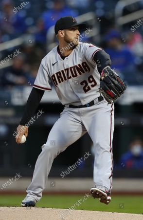 Arizona Diamondbacks starting pitcher Merril Kelly winds up during the first inning of the team's baseball game against the New York Mets, in New York