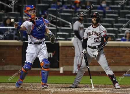 Arizona Diamondbacks' Christian Walker (53) reacts after striking out against the New York Mets during the third inning of a baseball game, in New York