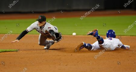 New York Mets' Francisco Lindor steals second base against Arizona Diamondbacks shortstop Nick Ahmed during the third inning of a baseball game, in New York