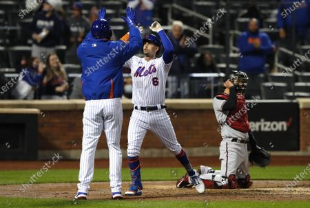 New York Mets' Joey Lucchesi and third baseman Jeff McNeil (6) celebrate after scoring on McNeil's home run against the Arizona Diamondbacks during the third inning of a baseball game, in New York