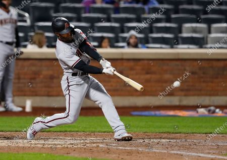 Arizona Diamondbacks' Christian Walker hits a single against the New York Mets in the sixth inning of a baseball game, in New York