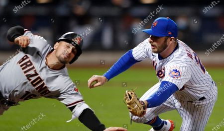 New York Mets first baseman Pete Alonso (20) tags out Arizona Diamondbacks' Tim Locastro (16) during the seventh inning of a baseball game, in New York