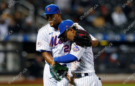 New York Mets relief pitcher Jeurys Familia (27) hugs Francisco Lindor after the top of the seventh inning against the Arizona Diamondbacks in a baseball game, in New York