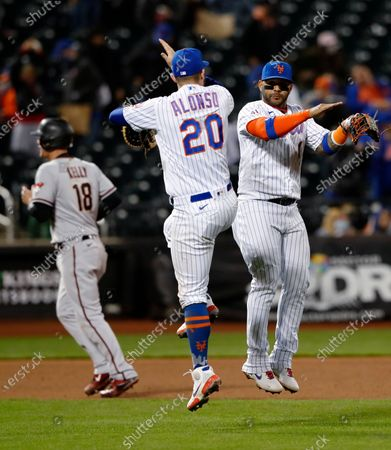 New York Mets' Pete Alonso (20) and Jonathan Villar (1) celebrate after the Mets defeated the Arizona Diamondbacks 4-2 in a baseball game, in New York