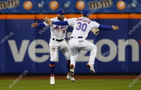 New York Mets' Kevin Pillar (11) and Michael Conforto (30) celebrate after the Mets defeated the Arizona Diamondbacks 4-2 in a baseball game, in New York