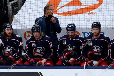 Stock Photo of Columbus Blue Jackets coach John Tortorella is seen behind Blue Jackets players defenseman Ryan MacInnis, left, forward Patrik Laine, forward Liam Foudy and forward Mikhail Grigorenko during an NHL hockey game against the Detroit Red Wings in Columbus, Ohio, . The Blue Jackets won 5-4 in overtime