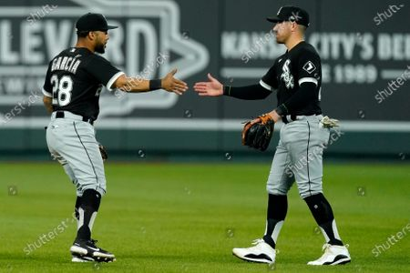 Stock Photo of Chicago White Sox center fielder Leury Garcia (28) and second baseman Danny Mendick celebrate after their baseball game against the Kansas City Royals, in Kansas City, Mo. The Chicago White Sox won 9-1