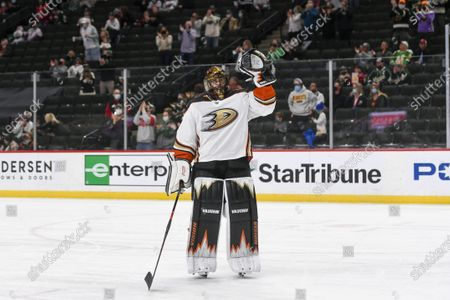 Anaheim Ducks goalie Ryan Miller waves to the crowd during a standing ovation after it was announced that this would be his last NHL hockey game, against the Minnesota Wild, in St. Paul, Minn