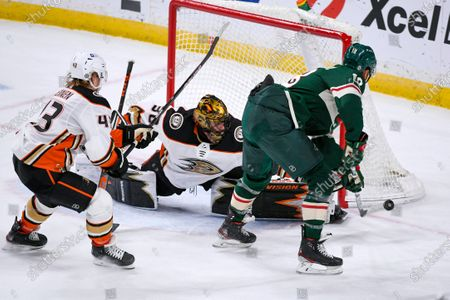 Stock Picture of Anaheim Ducks goalie Ryan Miller, center, stops a shot by Minnesota Wild left wing Jordan Greenway, right, as Ducks center Danton Heinen defends during the second period of an NHL hockey game, in St. Paul, Minn