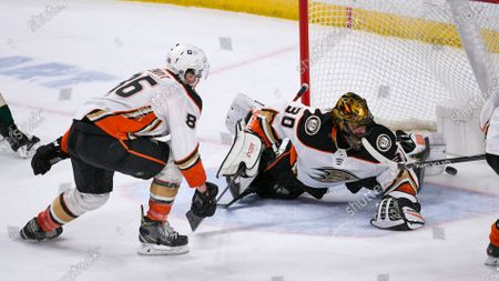 Anaheim Ducks goalie Ryan Miller, right, and defenseman Simon Benoit watch the puck slide into the goal on a wrist shot by Minnesota Wild right wing Ryan Hartman, not seen, during the second period of an NHL hockey game, in St. Paul, Minn