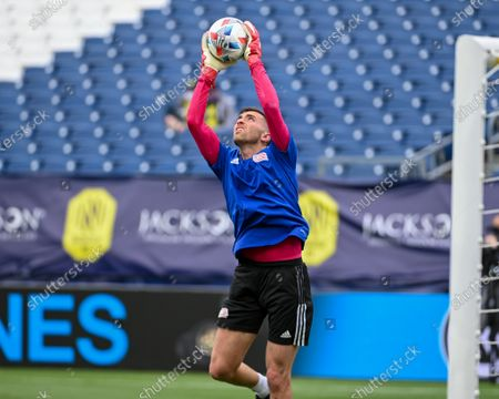 New England goalkeeper, Matt Turner (30), makes a jumping save during warm up at the MLS match between New England Revolution and Nashville SC at Nissan Stadium in Nashville, TN
