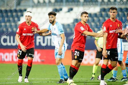 (L to R) Antonio Raillo, Juande Rivas, Aleksandar Sedlar and  MArtin Valjent in action during Malaga CF vs RCD Mallorca of La Liga Smartbank  2020/21 game at La Rosaleda Stadium. (Final score; Malaga CF 1:1 RCD Mallorca)