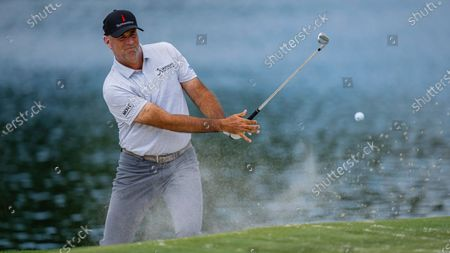 Stewart Cink hits out of the bunker on the 17th hole during the third round of the Wells Fargo Championship golf tournament at Quail Hollow, in Charlotte, N.C
