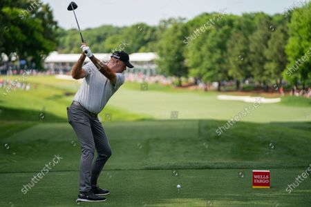 Stewart Cink tees off on the 18th hole during the third round of the Wells Fargo Championship golf tournament at Quail Hollow, in Charlotte, N.C