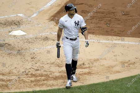 New York Yankees designated hitter Giancarlo Stanton reacts after striking out during the third inning of a baseball game against the Washington Nationals, at Yankee Stadium in New York