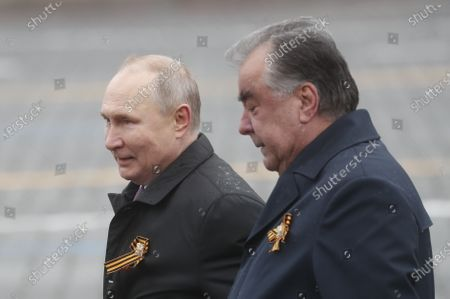 Russian President Vladimir Putin (L) and Tajik President Emomali Rahmon (R) walk in the Red Square after the Victory Day military parade in Moscow, Russia, 09 May 2021. Russia holds its Victory Day parade annually on 09 May to mark the surrender of Nazi Germany in 1945.