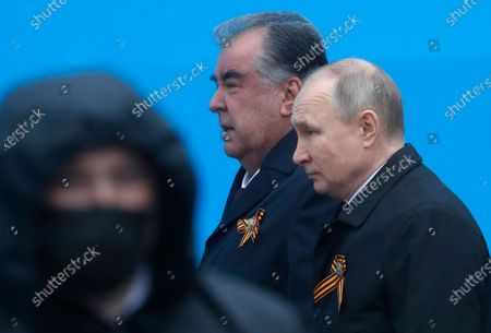 Russian President Vladimir Putin (R) and Tajik President Emomali Rahmon (2-R) arrive to attend the Victory Day military parade in the Red Square in Moscow, Russia, 09 May 2021. The Victory Day military parade takes place annually on 09 May in the Red Square to mark the surrender of Nazi Germany in 1945.